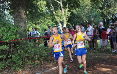Jenna Jolly and Niland Fortenberry race in the Chickasaw Invitational Cross Country Meet in Moulton Alabama.