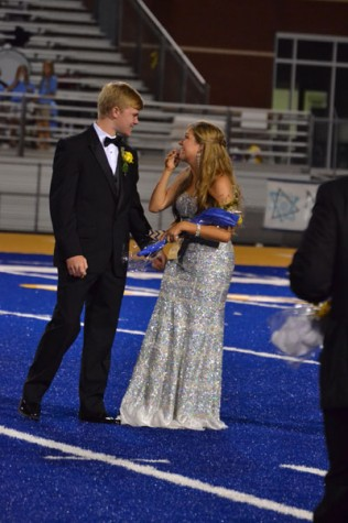 Neely Brown reacts as she is named Tupelo High School's Homecoming Queen on Sept. 26, 2014. Her escort is Carson Roberts.