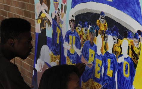 Tupelo High art students paint mural to show school spirit