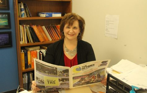 Stephanie Spires, the new Hi-Times adviser, smiles for a picture at her desk.
