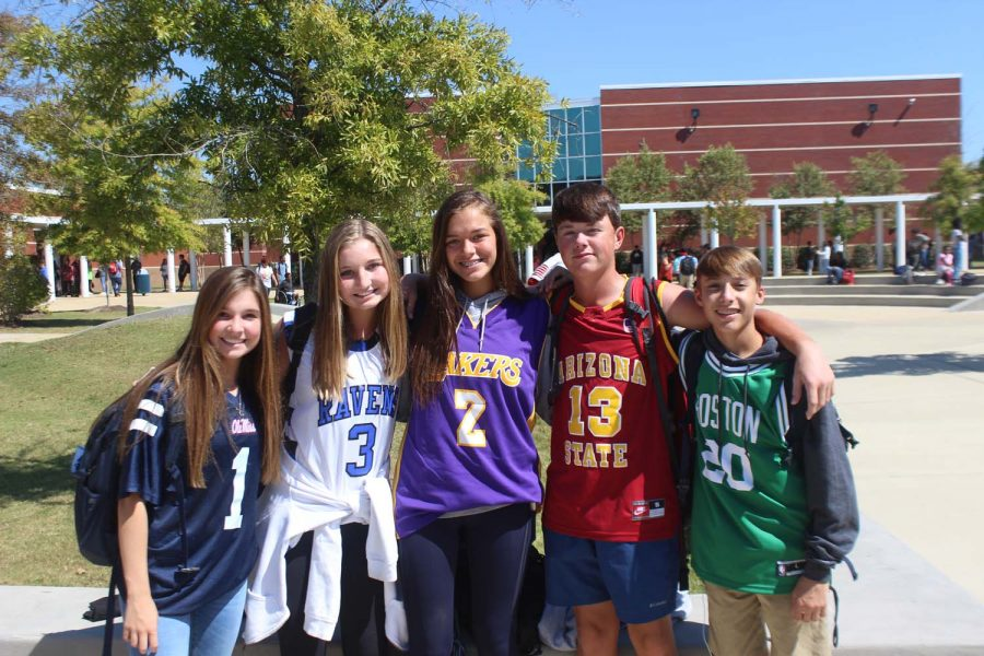 Freshmen: Evie Crawford, Vic Scoville, Walker Wise, Walker Cautrell, and Anne Raegan Sanders posing with their jerseys for Jersey Day
