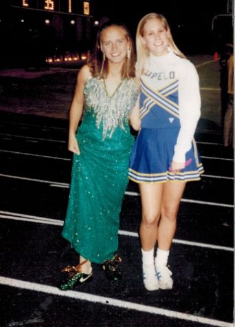 Senior Homecoming Maid, Ginger Enis poses with bedazzled cleats at Homecoming 1995.  Enis was also selected as Miss THS for the class of 1996.