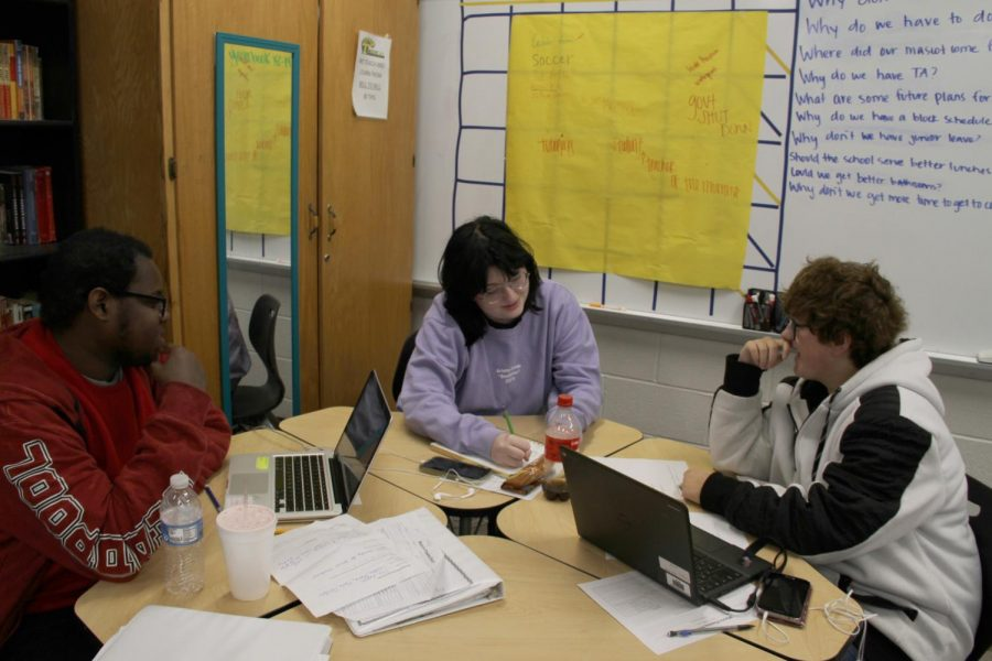 Zay Beene looks on while Laura Layton helps Gabby Adams plot out an editorial comic for the next issue of the Hi-Times during their first block Multi-Media Reporting Class.