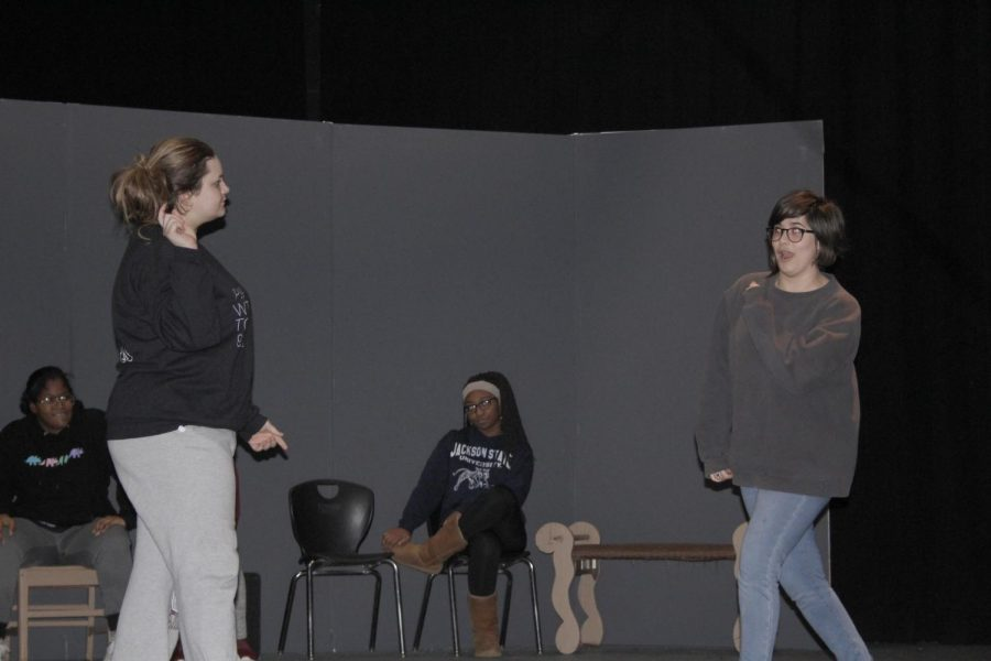 Karci Watson and Natalie Bowers perform for an audience during the February Improv Club Meeting.