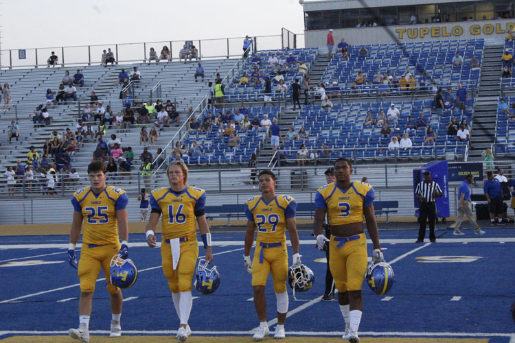 Tupelo walks up for the coin toss