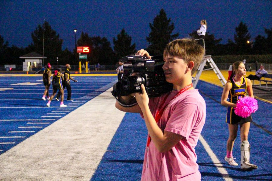 Ethan Robbins videos the game for WTHS.