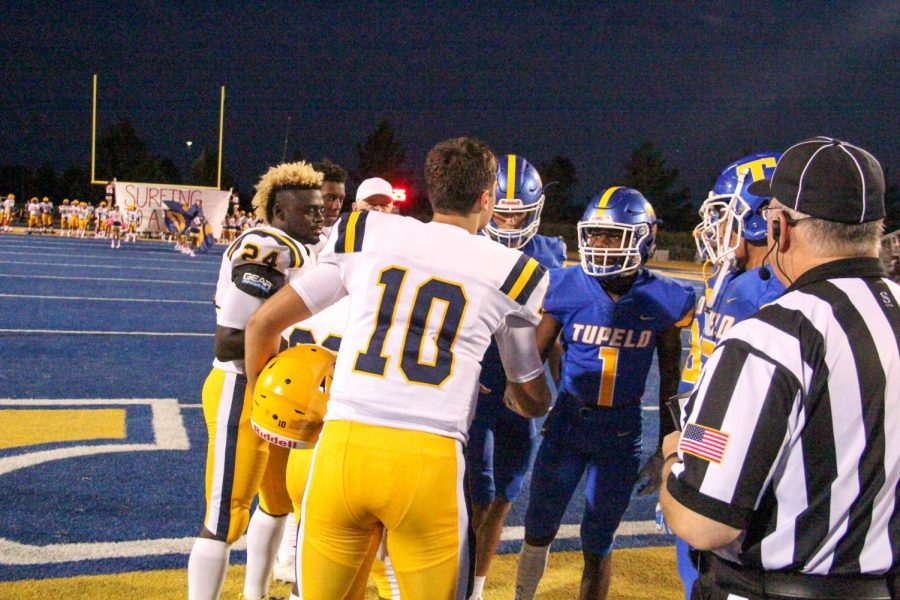 Team captain Adam Miller shakes hands with the Olive Branch captains prior to the coin toss at the beginning of the game.