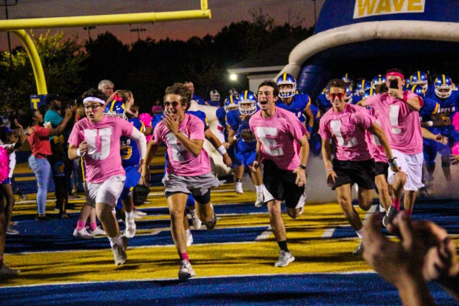 The Tupelo Boys lead the team onto the field for the game v. Olive Branch.