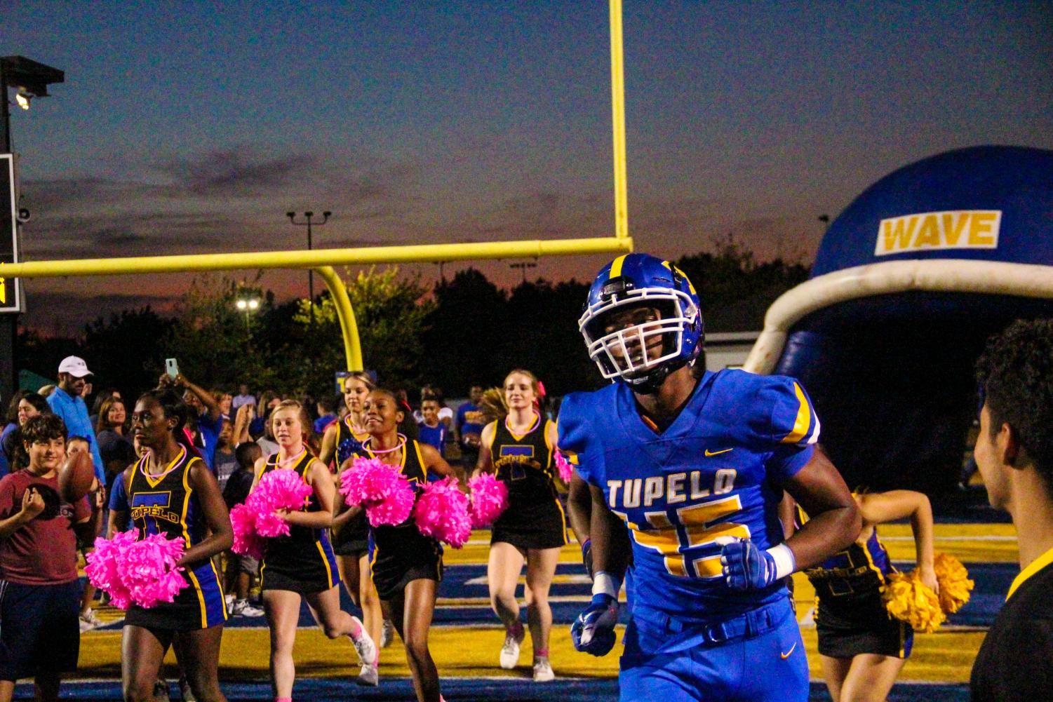 Quay Edwards runs onto the field before the varsity game v. Olive Branch on Oct. 4.
