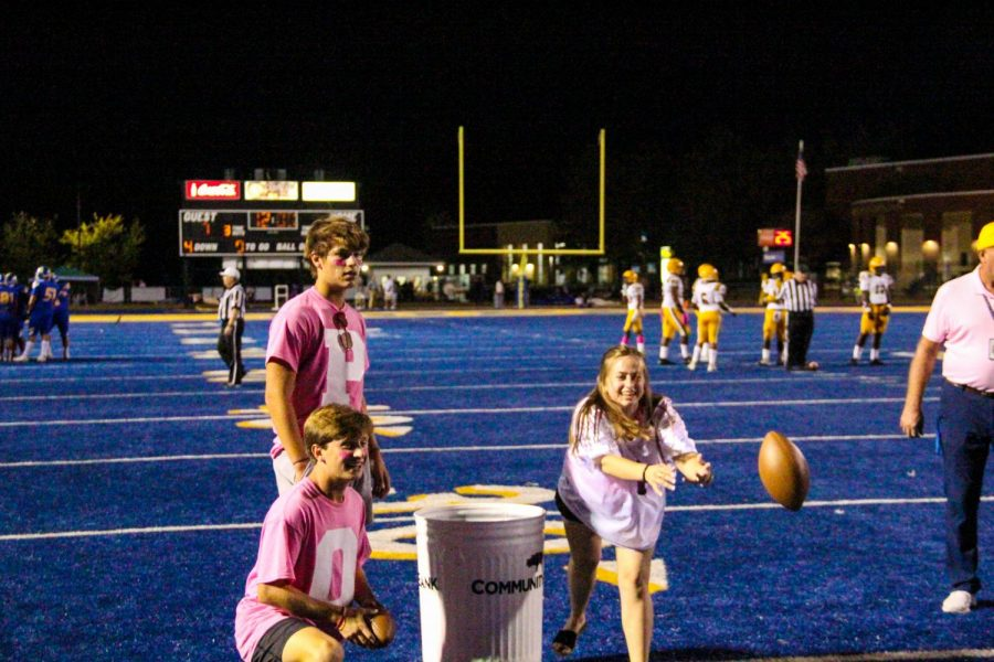 Lucy  Hill competes in the Community Bank Scholarship Challenge at the football game v. Olive Branch.