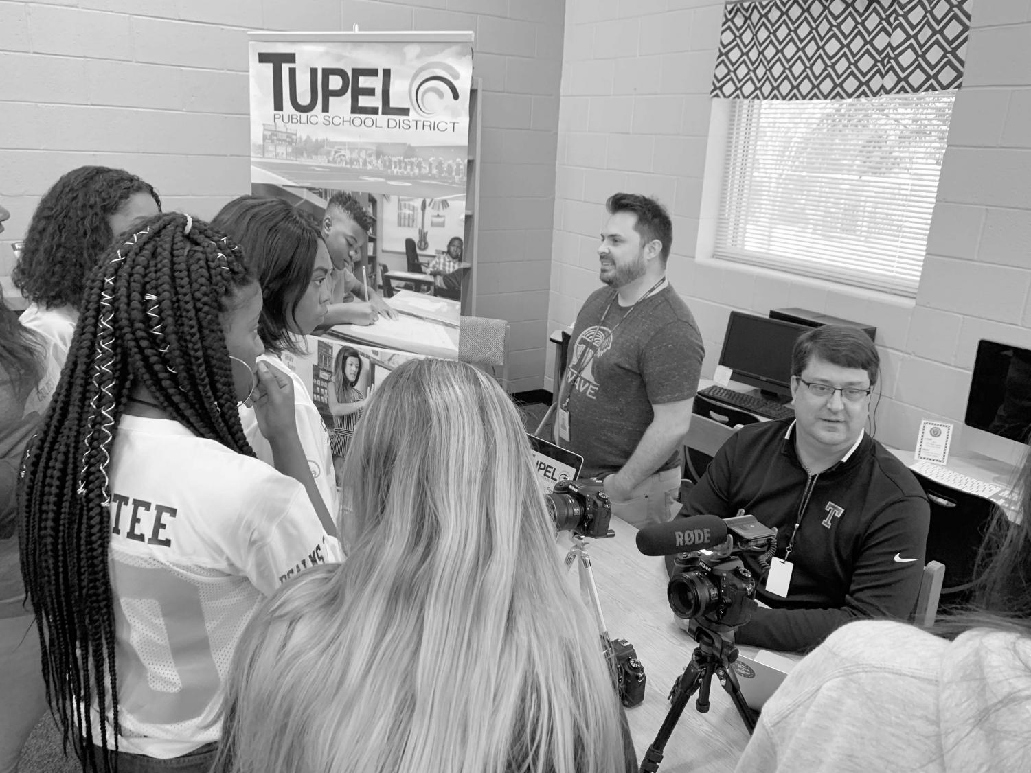 TPSD communications department members Ryan Coon, standing, and Greg Ellis speak to members of the THS Golden Wave Media staffs about how journalism relates to their career.
