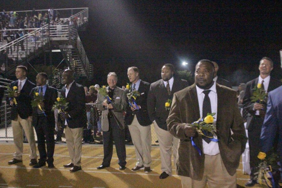 As a special addition to the court presentation, special men in the maids lives presented them with their traditional flower bouquet.