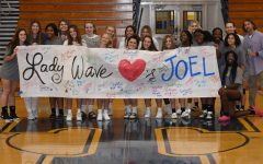The Lady Wave Volleyball teams shows their support for athletic trainer, Joel Kennedy, in his fight against cancer.