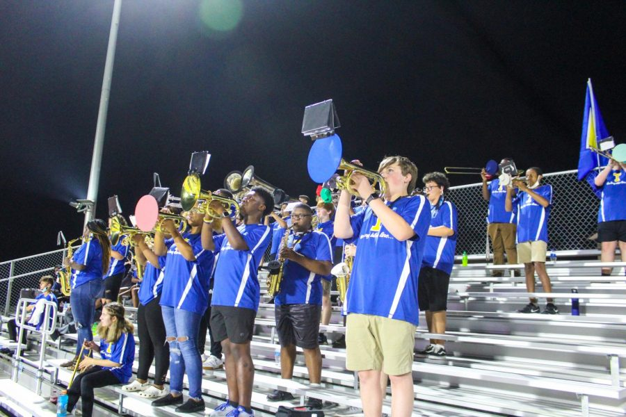 The Tupelo long blue line band plays on to inspire the team to keep pushing on.