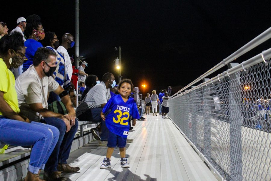 Kingsley Jones brother of Alivia Buchanan really shows Tupelo spirit as he enjoys the sounds of the game.