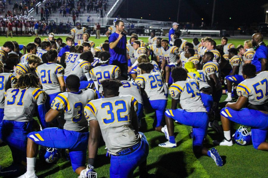 Head coach, Ty Hardin gives a after games speech to the Tupelo High School football team after the end of their first game.
