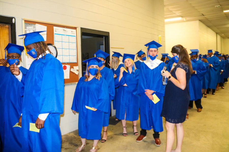 Tupelo High School Class of 2021 Graduation at BancorpSouth Arena, May 21, 2021.  Graduates gather behind stage in preparation for the their final act as THS students.