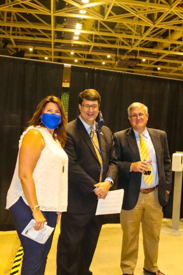 Tupelo High School Class of 2021 Graduation at BancorpSouth Arena, May 21, 2021.  Christy Weir, Gregg Ellis and Charles Laney check the set up behind the scenes before the ceremony.