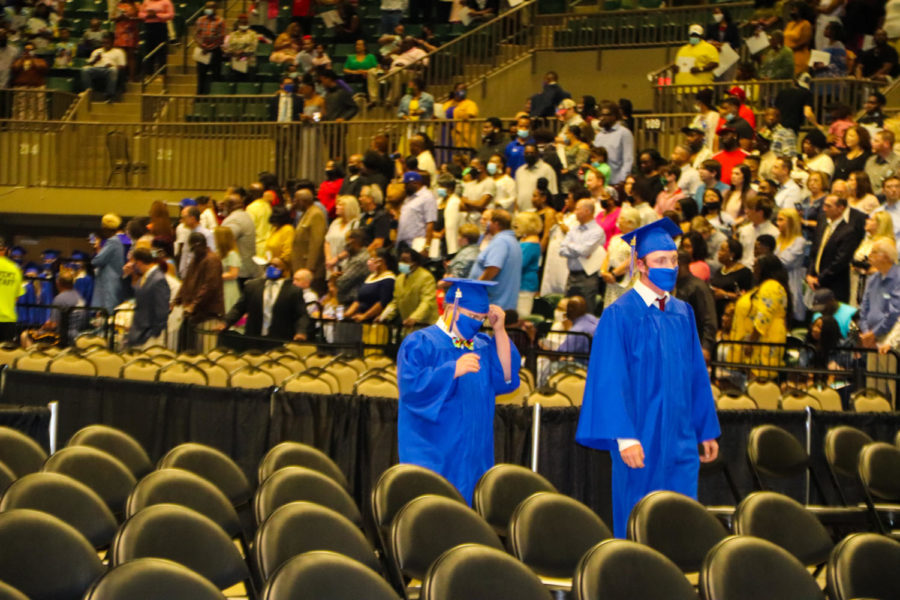Tupelo High School Class of 2021 Graduation at BancorpSouth Arena, May 21, 2021.  Graduates process in to the traditional Pomp and Circumstances played by the THS Band and Golden Wave Orchestra.