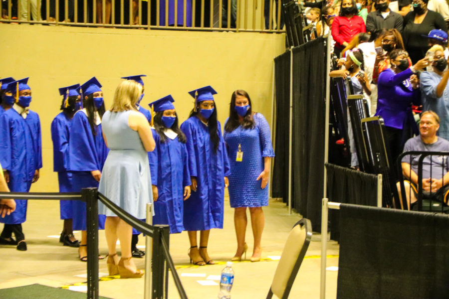 Tupelo High School Class of 2021 Graduation at BancorpSouth Arena, May 21, 2021.  Ms. Hendrix and Ms. Garner help the graduates process.