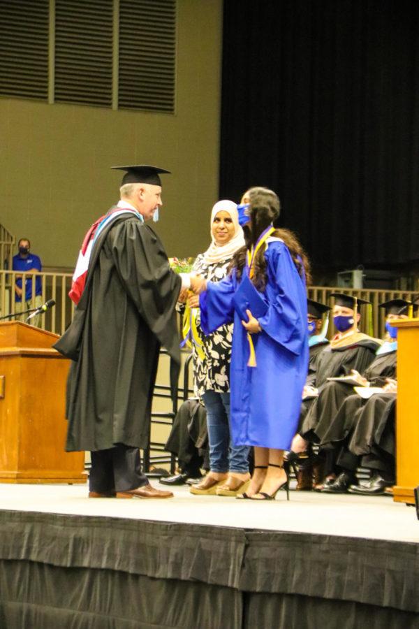 Tupelo High School Class of 2021 Graduation at BancorpSouth Arena, May 21, 2021.  Principal Art Dobbs congratulates Salutatorian Khaoula Kamal and her mother.
