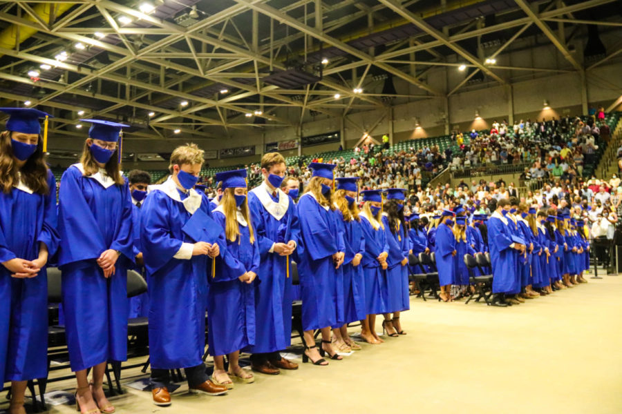 Tupelo High School Class of 2021 Graduation at BancorpSouth Arena, May 21, 2021.  Graduates bow their head for a final prayer by fellow student Halle Traylor.