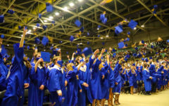 Tupelo High School Class of 2021 Graduation at BancorpSouth Arena, May 21, 2021.  Graduates participate in the traditional hat toss to conclude a ceremony that many weren't sure they would see at the beginning of the school year.