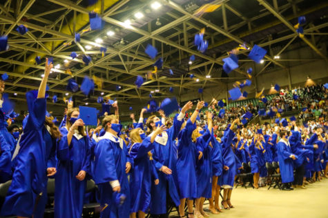 Tupelo High School Class of 2021 Graduation at BancorpSouth Arena, May 21, 2021.  Graduates participate in the traditional hat toss to conclude a ceremony that many weren